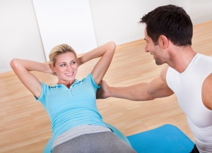 Fitness instructor teaching sit ups